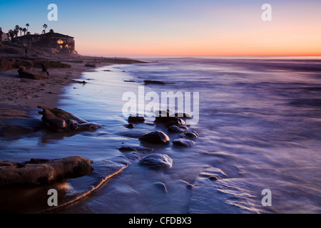 Rocks and beach at sunset, La Jolla, San Diego County, California, United States of America, - Stock Photo