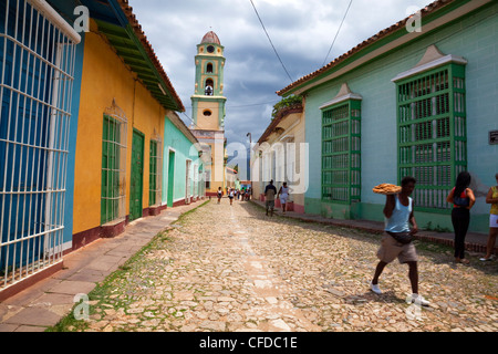 Man carrying tray of pastries along street in Trinidad, Sancti Spiritus Province, Cuba, West Indies, Central America - Stock Photo