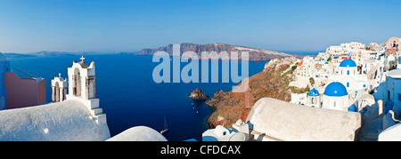 Blue domed churches in the village of Oia, Santorini (Thira), Cyclades Islands, Aegean Sea, Greek Islands, Greece, - Stock Photo
