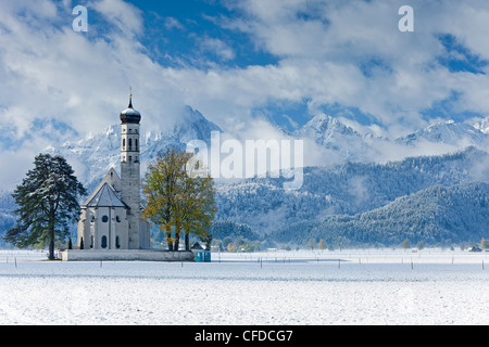 St. Coloman Church in winter, Oberbayern, Bavaria, Germany, Europe - Stock Photo