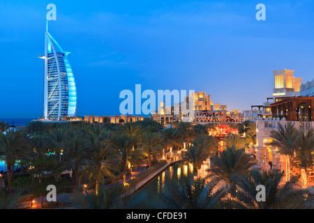 Burj Al Arab viewed from the Madinat Jumeirah Hotel at dusk, Jumeirah Beach, Dubai, United Arab Emirates, Middle - Stock Photo