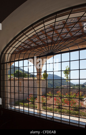 View out of a window at the monastery Sa Cartoixa, La Cartuja, Valldemossa, Tramuntana mountains, Mallorca, Balearic - Stock Photo