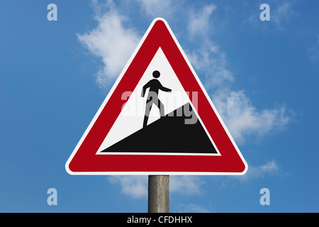 Detail photo of a danger sign 'Upward gradient', a man goes up, background sky. - Stock Photo