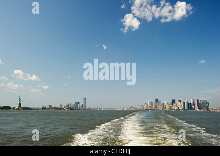 Manhattan Skyline and Statue of Liberty seen from Staten Island Ferry, Manhattan, New York, USA, America - Stock Photo