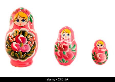Three Russian dolls over white - Stock Photo