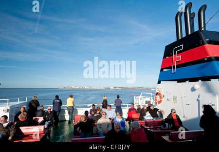 Passengers on ferry to Norderney island, East Frisian Islands, Lower Saxony, Germany - Stock Photo
