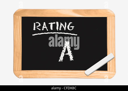 Detail photo of a chalkboard  with the inscription Rating A, white chalk lies in a corner, background white. - Stock Photo