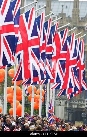 Flags and spectators outside Houses of Parliament, during the marriage of Prince William to Kate Middleton, London, - Stock Photo