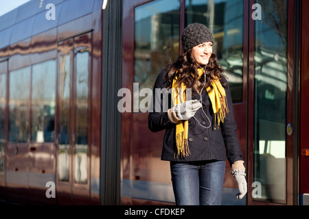 Woman using streetcar in city. - Stock Photo