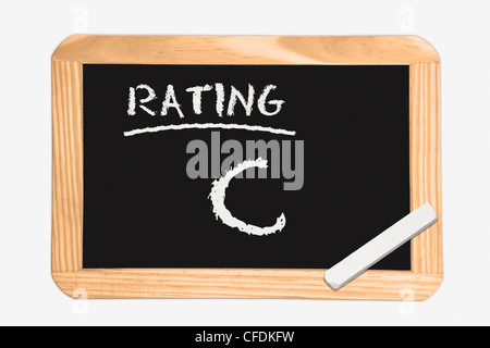 """Detail photo of a chalkboard with the inscription """"Rating C"""", white chalk lies in a corner, background white. - Stock Photo"""