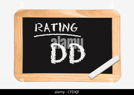 """Detail photo of a chalkboard with the inscription """"Rating DD"""", white chalk lies in a corner, background white. - Stock Photo"""