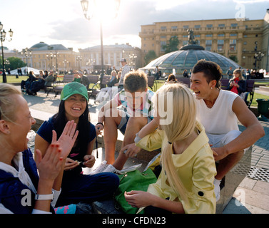 Teenage friends meeting up at Manege square, Moscow, Russia, Europe - Stock Photo