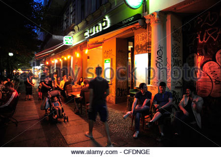 Evening mood, people in front of a cafe bar, street in Kreuzberg, Schlesisches Tor, Berlin, Germany - Stock Photo