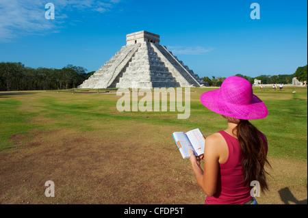 Tourist looking at El Castillo pyramid (Temple of Kukulcan) in the ancient Mayan ruins of Chichen Itza, Yucatan, - Stock Photo