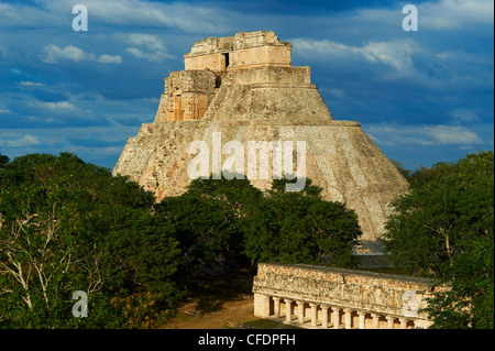 Pyramid of the Magician and The Ball Game Field, Mayan archaeological site, Uxmal, Yucatan State, Mexico - Stock Photo