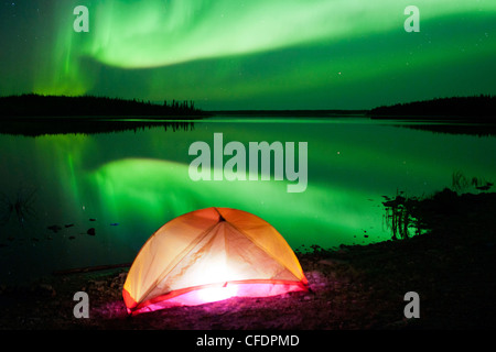 Tent and Aurora borealis (northern lights), boreal forest, Yellowknife environs, Northwest Territories, Canada - Stock Photo