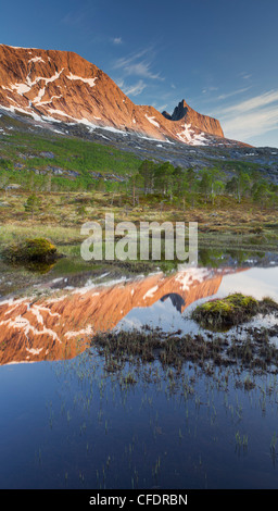 Mountain reflection in lake Sandholmvatnet, Hugelhornet near Skjellneset, Forsahavet, Ballangen, Nordland, Norway - Stock Photo