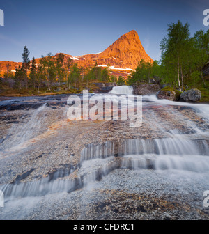 Stream running down the side of a rugged mountain, Kobbenestinden mountain in the background, Kobbeneset, Storelva, - Stock Photo