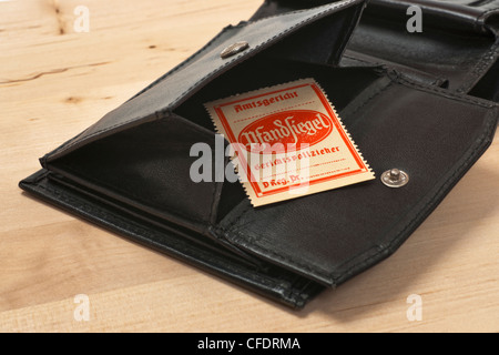 An open purse, inside is a bailiff's seal for distraint of goods. - Stock Photo