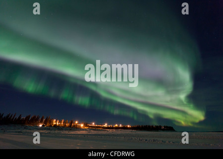 The aurora borealis, or northern lights, above the town of Tulita, Northwest Territories, Canada. - Stock Photo