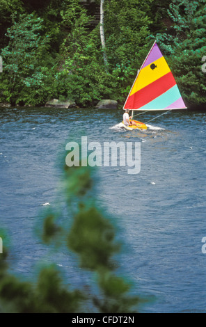 Water, boating activity during 4th of July antique boat parade on Lake Sunapee, New London, New Hampshire. - Stock Photo
