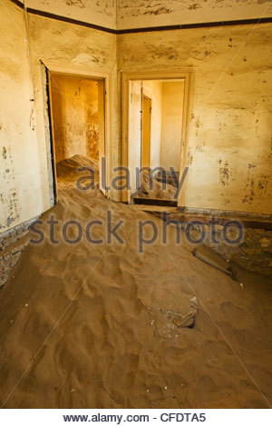 Sand filled hospital room at Kohlmanshop, a former diamond mining town in southern Namibia, Africa - Stock Photo