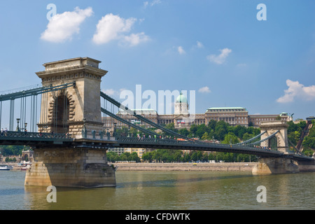 The Chain Bridge (Szechenyi Lanchid), over the River Danube, with the Hungarian National Gallery, behind, Budapest, - Stock Photo
