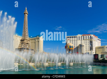 Rainbow by the dancing water fountains of the Bellagio hotel, The Strip, Las Vegas Boulevard South, Las Vegas, Nevada, - Stock Photo