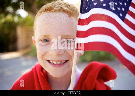 Patriotic Boy with American Flag - Stock Photo