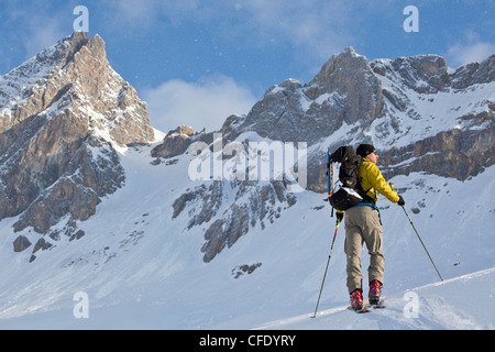 A man ski touring while on a backcountry ski hut trip in the canadian rockies near Golden, British Columbia, Canada - Stock Photo