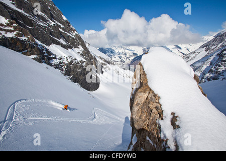 A male backcountry skier finds fresh powder while on a hut trip at Icefall Lodge, Golden, British Columbia, Canada - Stock Photo