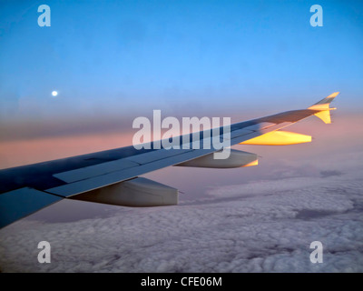 View from a window of an Airbus 320 Commercial Airliner Wing over Greenland - Stock Photo