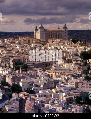 A cathedral rises from the historic walled city of Toledo, Spain - Stock Photo