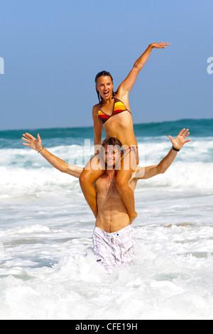 Couple of surfers, Esquinzo beach, Cotillo, Fuerteventura. Canary Islands, Spain, Atlantic, Europe - Stock Photo