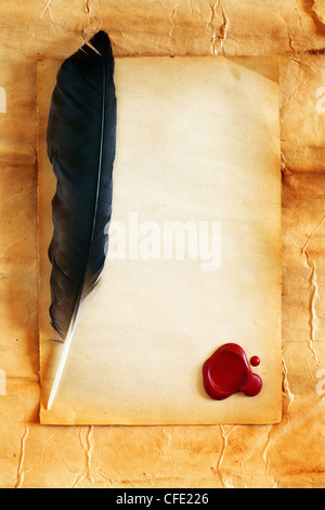 Quill on blank paper with wax seal - Stock Photo