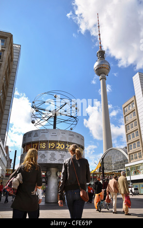 Two Berlin landmarks, the World Time Clock and TV Tower, shot from Alexanderplatz on a blue-sky summer's day. - Stock Photo