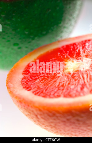 Close up of green apple and grapefruit isolated on white - Stock Photo