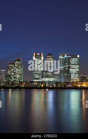 Canary Wharf financial district viewed over the river Thames, London, UK - Stock Photo
