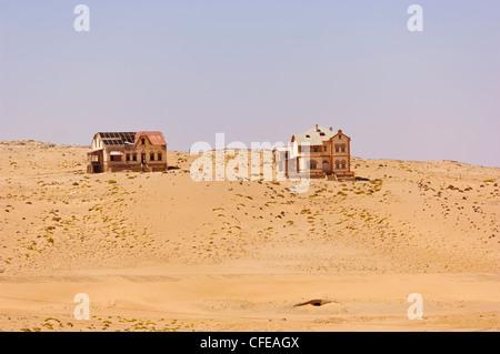 Abandoned houses of the mining ghost town Kolmanskop near Luderitz, Namibia - Stock Photo