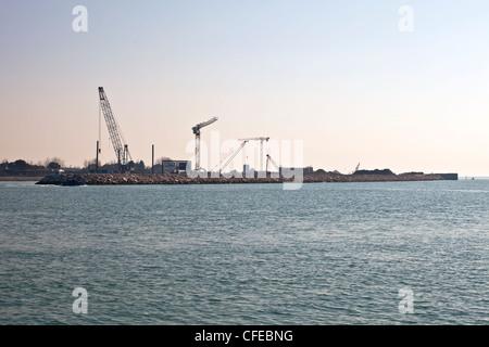 Construction site, lagoon of Venice, MO.SE, Modulo Sperimentale Elettromeccanico, water dam, Italy - Stock Photo