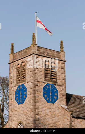 Flag flies high on picturesque St Peter's Church tower & time on 2 clocks reads 6.00pm - sunny spring evening, Addingham - Stock Photo