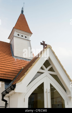 Close-up detail of porch, tiled roof & tower of St James's Church (unique pretty little white timber building)  - Stock Photo