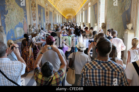 Tourists in the Vatican Museum - Stock Photo