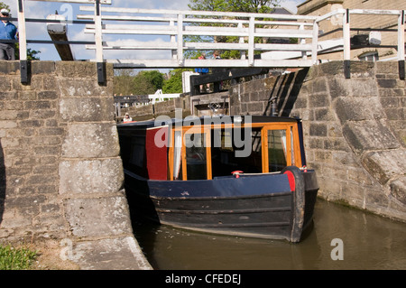 Narrowboat emerging, after passing through The Five Rise Locks - Bingley, Leeds Liverpool Canal, West Yorkshire, - Stock Photo