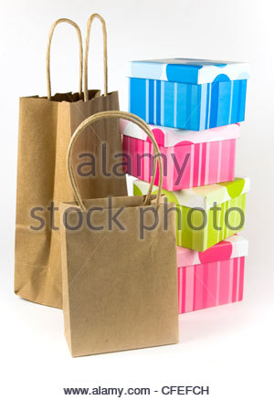 Still life of empty paper bags and colorful gift boxes - Stock Photo