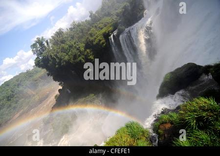 Rainbow in Iguazu Falls - Stock Photo