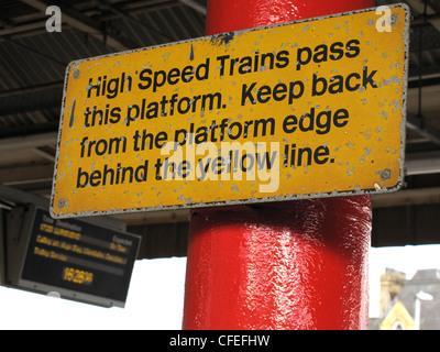 High Speed Trains pass this platform sign, keep back from platform edge at Warrington Bank Quay Railway Station, - Stock Photo