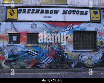 Inner city Manchester graffiti at Greenbow Motors 51 New Wakefield St - Stock Photo