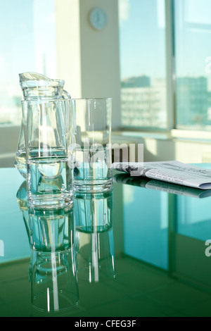 Workplace with glassware and newspaper - Stock Photo