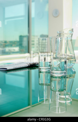 Close-up of glassware and newspaper on table - Stock Photo